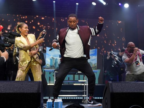 """BUDAPEST, HUNGARY – SEPTEMBER 25: Jada Pinkett Smith (L) watches husband Will Smith perform on stage with DJ Jazzy Jeff (not pictured) during the Paramount Pictures, Skydance and Jerry Bruckheimer Films """"Gemini Man"""" Budapest concert at St Stephens Basilica Square on September 25, 2019 in Budapest, Hungary. (Photo by Ian Gavan/Getty Images for Paramount Pictures)"""