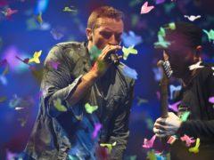 Chris Martin of Coldplay performs at Glastonbury (Ben Birchall/PA)
