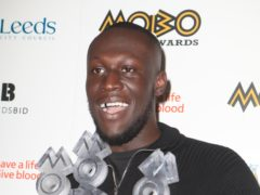 Stormzy with his best male, best album and best grime star awards at the 2017 Mobo Awards in Leeds (Danny Lawson/PA)