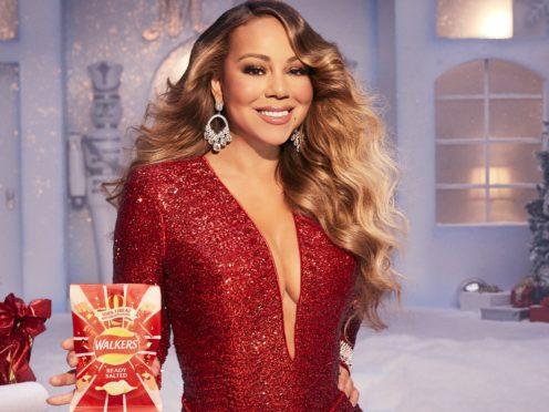 Mariah Carey tussles with elf in Walkers Christmas advert (Walkers/PA)