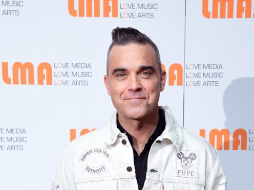 Robbie Williams says he will be voting for the first time in the General Election (Ian West/PA)