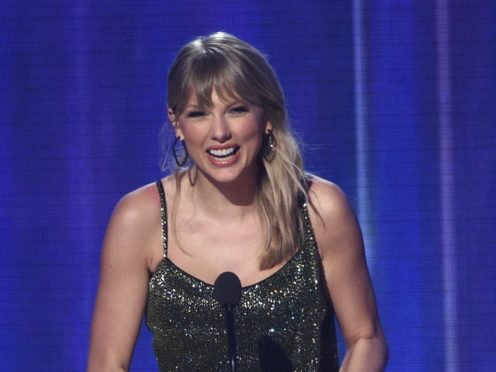 Taylor Swift toasted her fans as she was named artist of the decade at the American Music Awards (Chris Pizzello/Invision/AP)