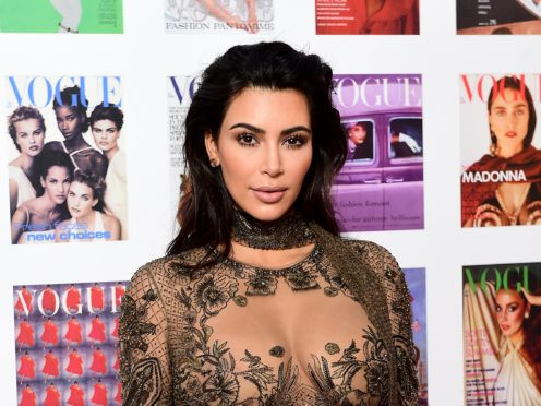 Kim Kardashian West has revealed why she photoshopped daughter North into the family Christmas card (Ian West/PA Wire)