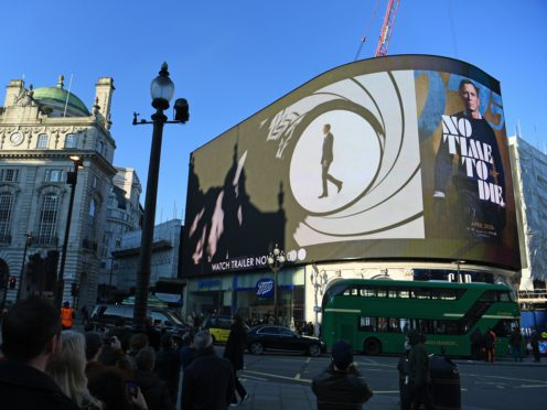 The trailer for the latest Bond film No Time to Die is aired for the first time on the large screen in London's Piccadilly Circus (Victoria Jones/PA)