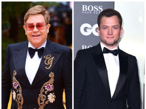 Sir Elton John and Taron Egerton (PA)