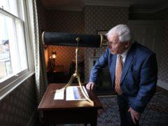 Sir David Attenborough looks through a telescope in what was JMW Turner's bedroom (Jonathan Brady/PA)