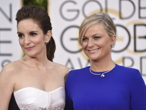 Tina Fey, left, and Amy Poehler will host next year's Golden Globes (John Shearer/Invision/AP)