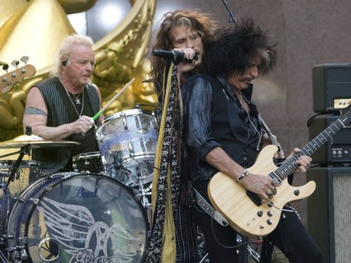 Drummer Joey Kramer, singer Steven Tyler and guitarist Joe Perry of Aerosmith perform together in 2018. A judge has denied Kramer's bid to rejoin the band for Grammy week (Charles Sykes/AP)