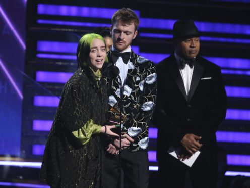 """Billie Eilish, left, and Finneas O'Connell pose in the press room with the awards for best album, best engineered album and best pop vocal album for """"We All Fall Asleep, Where Do We Go?,"""" best song and record for """"Bad Guy,"""" best new artist and best producer, non-classical at the 62nd annual Grammy Awards at the Staples Center on Sunday, Jan. 26, 2020, in Los Angeles. (AP Photo/Chris Pizzello)"""