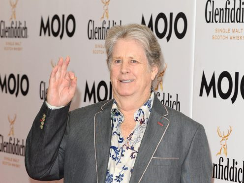 Brian Wilson has called on his former band The Beach Boys to cancel a planned performance at a trophy-hunting convention (Ian West/PA)