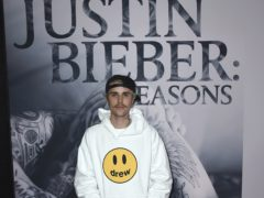 Justin Bieber has spoken candidly about his drug use and revealed at his lowest point he would wake up and immediately smoke cannabis and swallow pills (Jordan Strauss/Invision/AP)