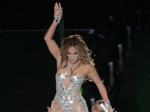 Jennifer Lopez took aim at Donald Trump's immigration policies as she shared a video of the moments before she took to the stage at the Super Bowl (AP Photo/Charlie Riedel)