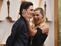 Timothee Chalamet photobombs Margot Robbie on Oscars red carpet (Richard Shotwell/AP)