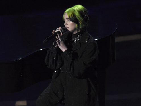 Billie Eilish performed during the in memoriam tribute at the Oscars, but the segment was criticised for not including Luke Perry (AP Photo/Chris Pizzello)