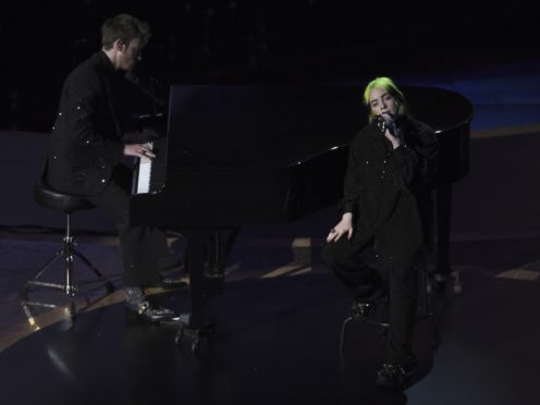 Finneas O'Connell and Billie Eilish perform during the In Memoriam section (AP/Chris Pizzello/PA)