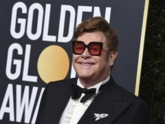 Sir Elton John, seen here at the recent Golden Globe Awards, says he is determined to complete concerts in New Zealand this week as scheduled despite a bout of illness (Jordan Strauss/AP)