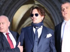 Actor Johnny Depp (centre) leaving the High Court in London after attending a hearing in his libel case against the publishers of The Sun and its executive editor, Dan Wootton (Yui Mok/PA)