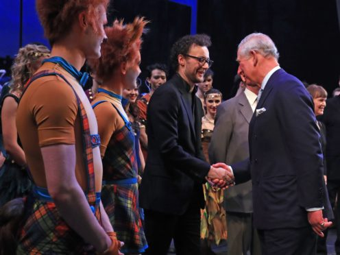 The Prince of Wales shakes hands with choreographer Liam Scarlett as he attends the world premiere of the ballet, The Cunning Little Vixen (Gareth Fuller/PA)