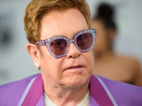 Sir Elton John has said he hopes the coronavirus pandemic will bring people closer together (Matt Crossick/PA)