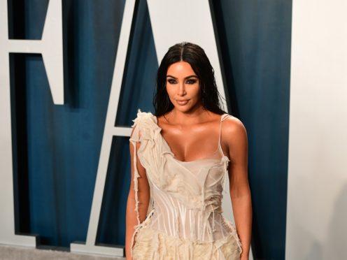 The cause of Kim and Kourtney Kardashian's headline-making fight has been revealed (Ian West/PA)