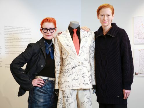 A suit signed by a host of A-list celebrities has fetched £16,000 after it was auctioned off to raise funds for a campaign to save late artist and filmmaker Derek Jarman's cottage (Matt Alexander/PA)