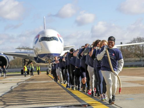 Nicola Adams, Gabby Logan, Gary Lineker, Joe Wicks, Iwan Thomas and Alfie Hewett pulling the plane (Steve Parsons/PA)