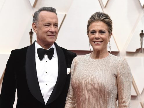 """Tom Hanks said he and wife Rita Wilson are taking it """"one day at a time"""" after they were both diagnosed with Covid-19 (Jordan Strauss/Invision/AP, File)"""