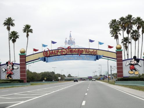 The road to the entrance of Walt Disney World in Florida, as the entertainment industry grapples with a pandemic (AP Photo/John Raoux)
