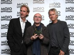 For use in UK, Ireland or Benelux countries only Undated BBC handout photo of presenter Zoe Ball with (left to right) Mike Rutherford, Phil Collins and Tony Banks of Genesis, appearing on Radio 2's The Zoe Ball Breakfast Show, where it was announced that the band are reuniting as Genesis for their first tour in 13 years.
