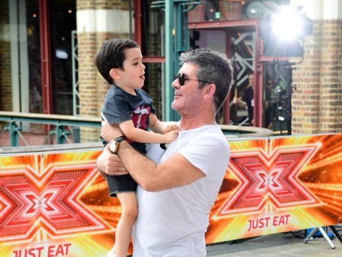 Simon Cowell and son Eric Cowell (Ian West/PA)
