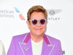 Sir Elton John has hailed 99-year-old war veteran Captain Tom Moore as 'an amazing man' (Matt Crossick/PA)