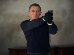 Daniel Craig (right) holding a signed clapperboard for No Time To Die (Bonhams/PA)