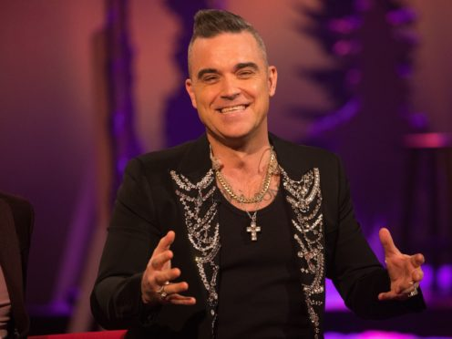 Robbie Williams said his experiences with the paranormal have stopped since he became a father (PA Images on behalf of So TV)