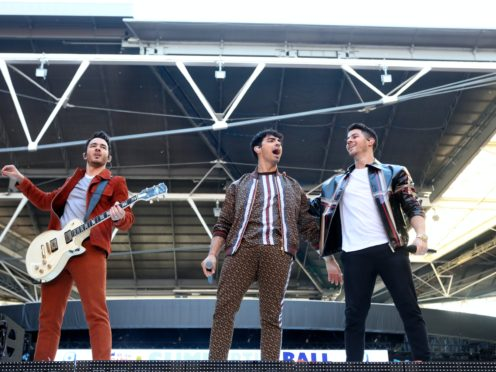 Kevin Jonas, Joe Jonas and Nick Jonas have joined the billing (Isabel Infantes/PA)