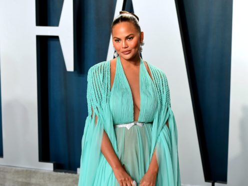 Chrissy Teigen said criticism from a prominent cookbook author 'hit me hard' after she was accused of running a 'content farm' (Ian West/PA)