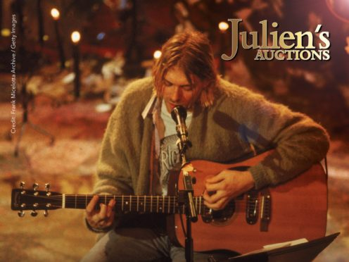 The guitar used by Nirvana frontman Kurt Cobain during the band's famous MTV Unplugged in New York concert sold for a staggering 6 million dollars (about £4.9 million) at auction (Julien's Auctions/PA)