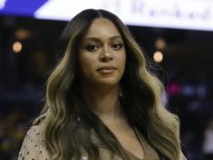 Beyonce urged fans to 'vote like our life depends on it' as she delivered an impassioned address calling for the dismantling of 'a racist and unequal system' (AP Photo/Ben Margot, File)