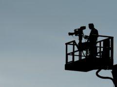 A television camera operator (Andrew Matthews/PA)