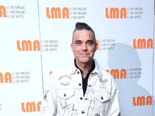 Robbie Williams said he was threatened with being beheaded while working for a charity in Haiti following the 2010 earthquake (Ian West/PA)