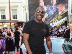 Idris Elba accepts his award (Bafta/PA)