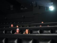 Film goers at the Showcase Cinema at Bluewater in Kent sit down, socially distanced, to watch a film on Saturday July 4 (Stefan Rousseau/PA)