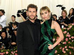 Miley Cyrus and Liam Hemsworth (Jennifer Graylock/PA)