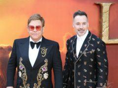 Sir Elton John and David Furnish signed the letter (Jonathan Brady/PA)