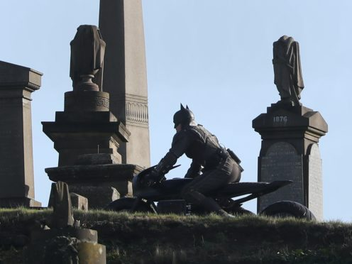 A man dressed as Batman during filming at the Glasgow Necropolis cemetery (Andrew Milligan/PA)