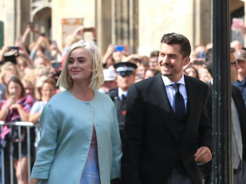 """Katy Perry and Orlando Bloom said they are """"floating with love and wonder"""" following the birth of their first child together (Peter yrne/PA)"""