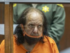 Adult film star Ron Jeremy has been charged with an additional 20 counts of sexual assault involving 13 women (David McNew/via AP)
