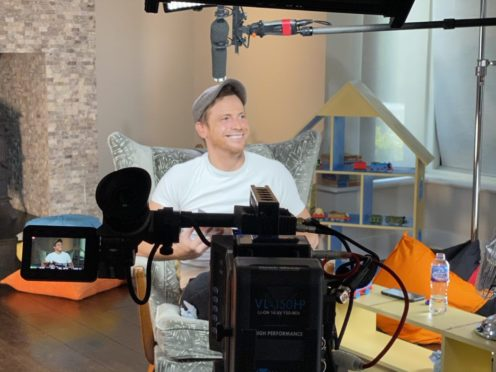 Joe Swash reads from Stay Safe With Thomas (Network Rail/Thomas And Friends/PA)