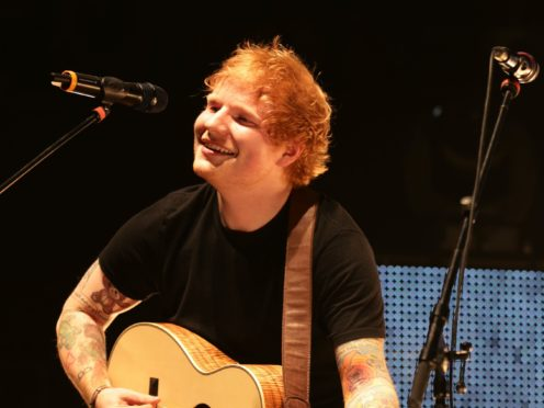 Ed Sheeran performing on stage during the Teenage Cancer Trust series of charity gigs (Yui Mok/PA)
