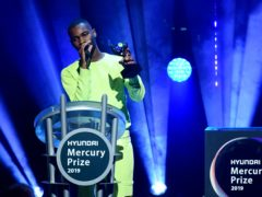 Dave accepts the Mercury Prize in 2019 (Ian West/PA)
