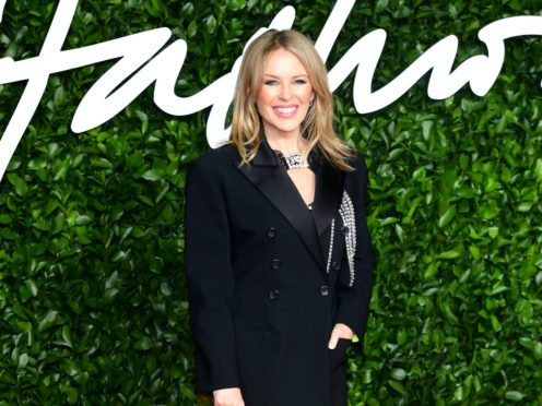 Kylie Minogue has heaped praise on boyfriend Paul Solomons for sticking by her side when she fell ill on tour (Ian West/PA Wire)
